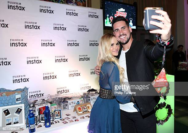 TV personalities Amanda Stanton and Josh Murray attend the 1027 KIIS FM Artist Gift Lounge presented by FUJIFILM INSTAX at iHeartRadio's Jingle Ball...