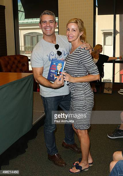 Personalities Andy Cohen and Camille Grammer attend the signing of Andy Cohen's new book The Andy Cohen Diaries A Deep Look At A Shallow Year at...