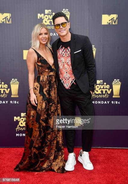TV personalities Ariana Madix and Tom Sandoval attend the 2018 MTV Movie And TV Awards at Barker Hangar on June 16 2018 in Santa Monica California