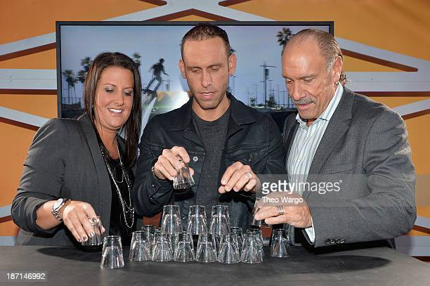 TV personalities Ashley Broad Seth Gold and Les Gold participate at the Guinness World Records Unleashed Arena in Times Square on November 6 2013 in...