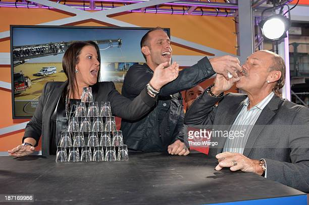 Personalities Ashley Broad, Seth Gold, and Les Gold participate at the Guinness World Records Unleashed Arena in Times Square on November 6, 2013 in...