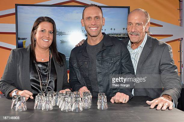 Personalities Ashley Broad, Seth Gold, and Les Gold pose at the Guinness World Records Unleashed Arena in Times Square on November 6, 2013 in New...