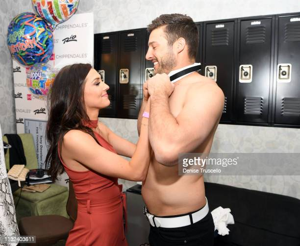 TV personalities Becca Kufrin and Garrett Yrigoyen backstage at Chippendales Las Vegas at the Rio AllSuit Hotel and Casino on March 23 2019 in Las...