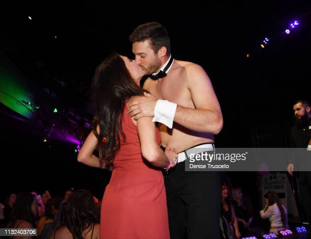 TV personalities Becca Kufrin congratulates Garrett Yrigoyen at the end of the Chippendales Las Vegas show where he guest starred at the Rio AllSuit...