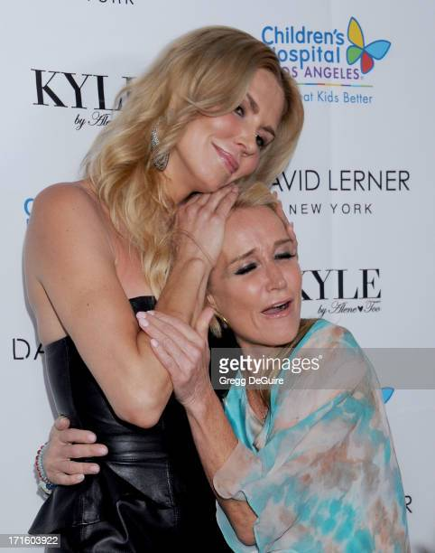 TV personalities Brandi Glanville and Kim Richards of The Real Housewives of Beverly Hills arrive at a fashion fundraiser hosted by Kyle Richards...
