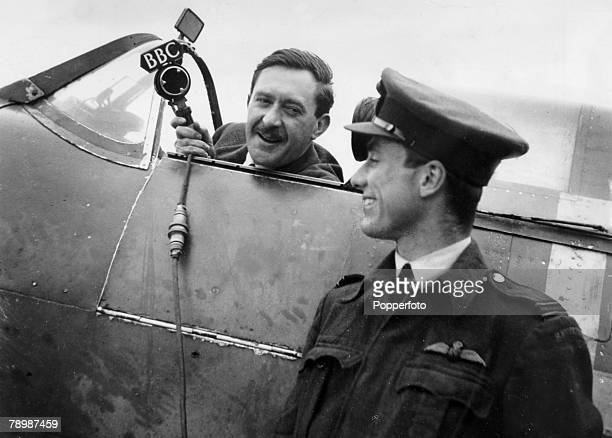 1943 BBC Commentator Gilbert Harding pictured in the cockpit of a RAF Spitfire during World War Two