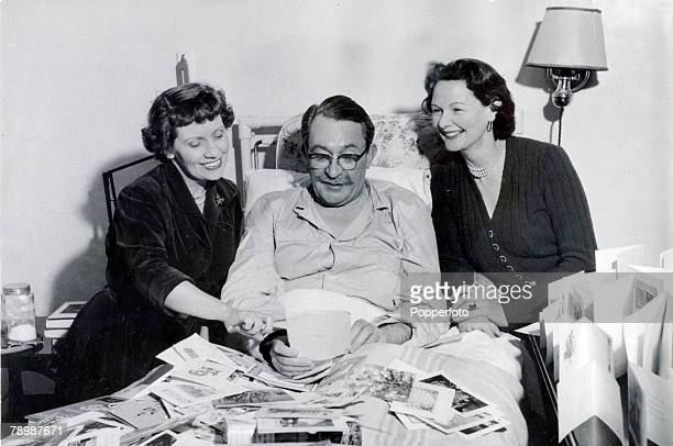 1953 BBC personality Gilbert Harding pictured in hospital recovering from double pneumonia and visited by leftright Anona Winn and Elizabeth Allan