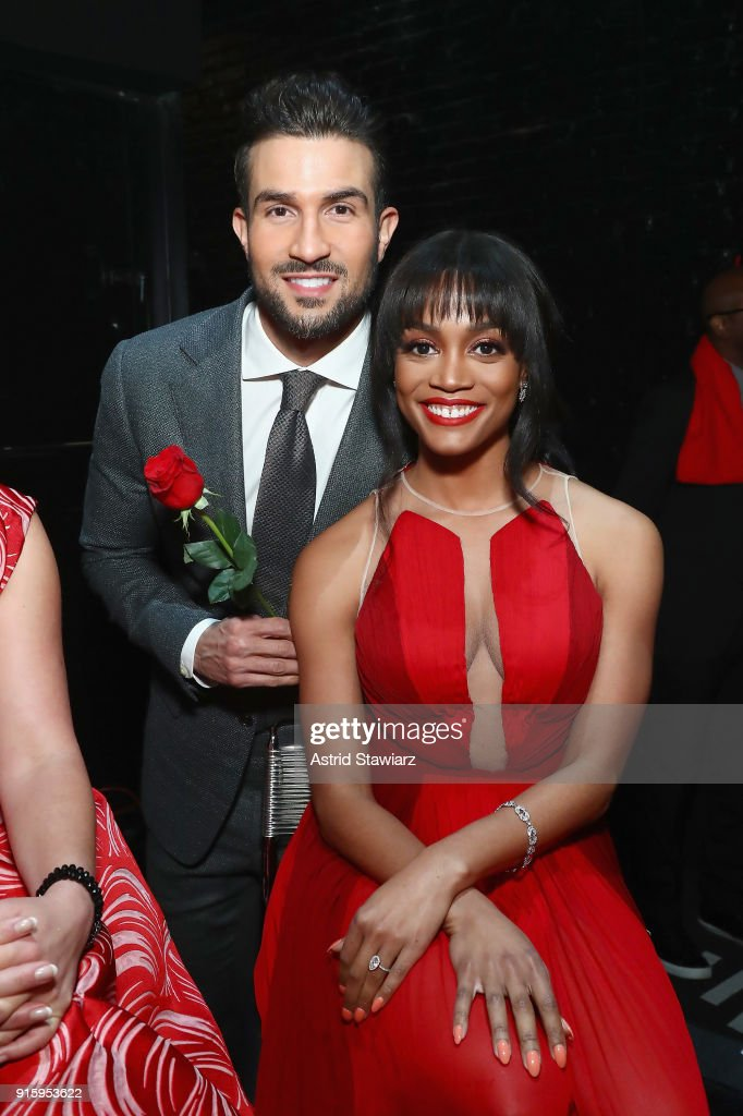 TV personalities Bryan Abasolo (L) and Rachel Lindsay pose backstage at the American Heart Association's Go Red For Women Red Dress Collection 2018 presented by Macy's at Hammerstein Ballroom on February 8, 2018 in New York City.