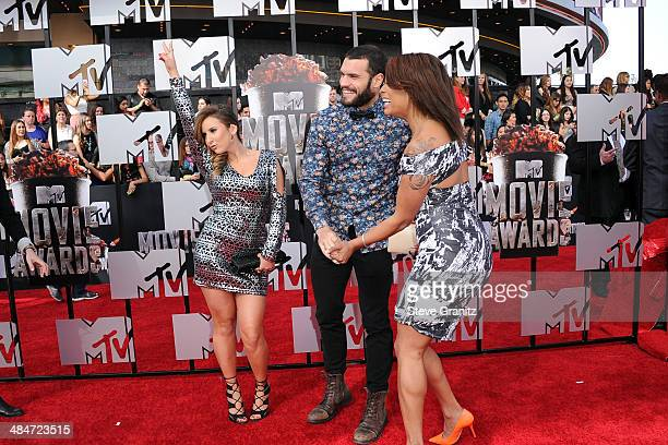 TV personalities Camila Nakagawa Frank Sweeney and Aneesa Ferreira attend the 2014 MTV Movie Awards at Nokia Theatre LA Live on April 13 2014 in Los...
