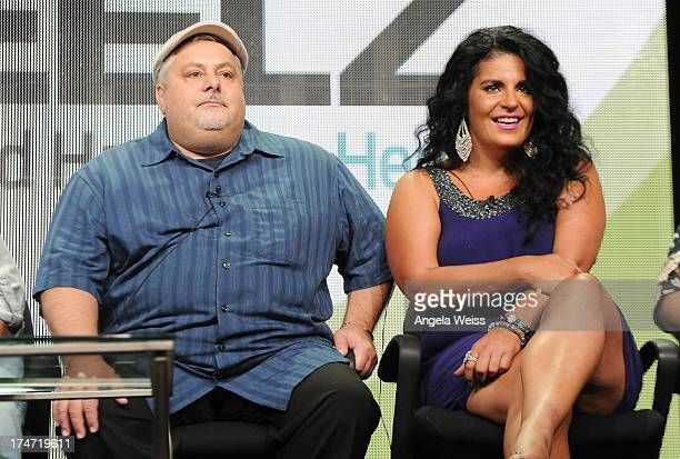 TV personalities Carmine Perelli and Madeline Santarelli speak onstage during 'The Capones' panel discussion at the ReelzChannel portion of the 2013...
