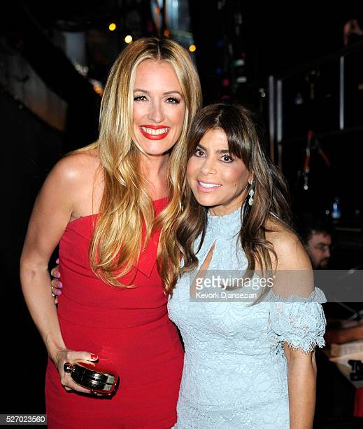 TV personalities Cat Deeley and Paula Abdul pose backstage during the 2016 American Country Countdown Awards at The Forum on May 1 2016 in Inglewood...