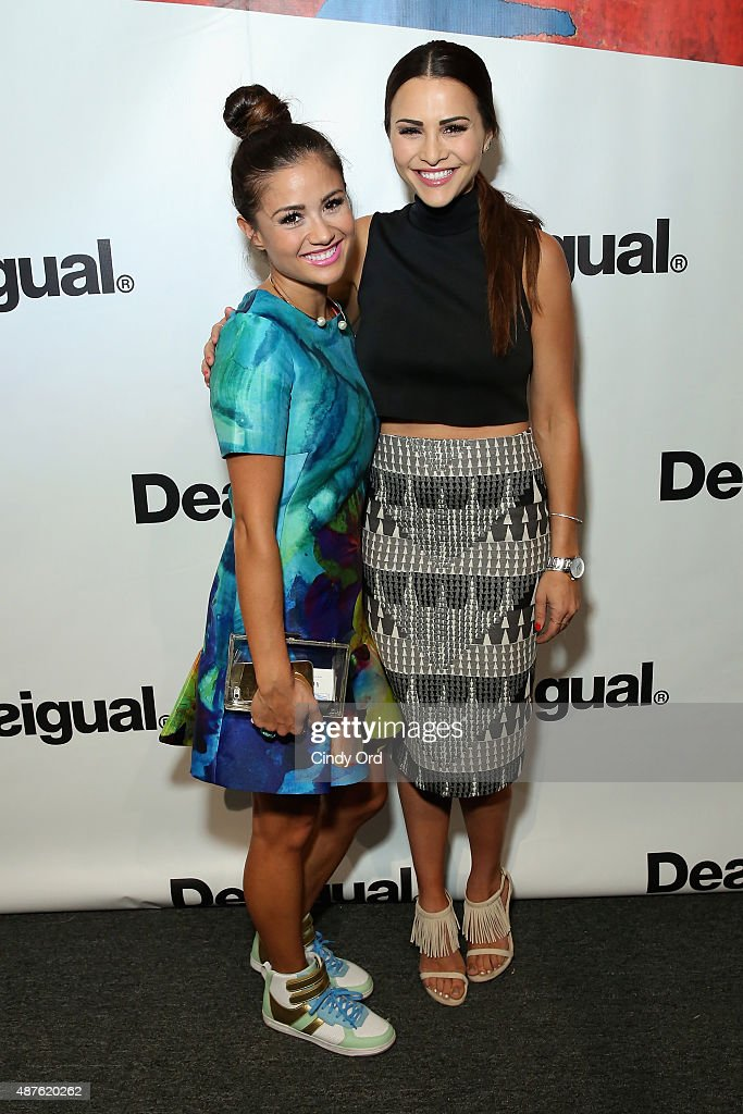 T.V. personalities Catherine Giudici Lowe and Andi Dorfman pose backstage at the Desigual fashion show during Spring 2016 New York Fashion Week: The Shows at The Arc, Skylight at Moynihan Station on September 10, 2015 in New York City.