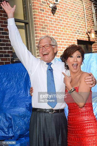 TV personalities David Letterman and Julie Chen pose for photos at the Late Show With David Letterman taping at the Ed Sullivan Theater on September...