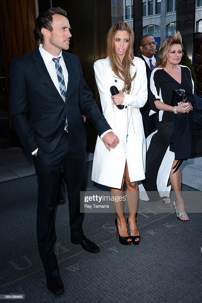 TV personalities Doug McLaughlin (L) and Lydia McLaughlin leave their Soho hotel on April 3, 2013 in New York City.