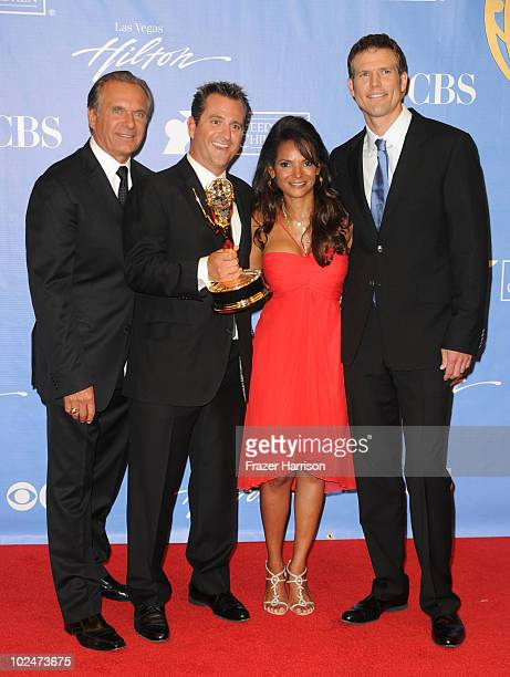 TV personalities Dr Andrew Ordon Dr Jim Sears Dr Lisa Masterson and Dr Travis Stork pose with the Outstanding Informative Talk Show Award in the...