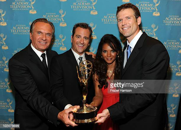 TV personalities Dr Andrew Ordon Dr Jim Sears Dr Lisa Masterson and Dr Travis Stork pose with the Outstanding Informative Talk Show in the trophy...