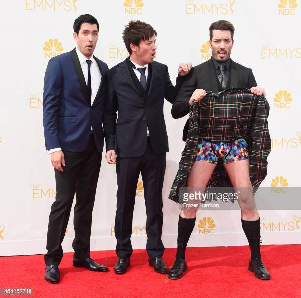 TV personalities Drew Scott JD Scott and Jonathan Silver Scott attend the 66th Annual Primetime Emmy Awards held at Nokia Theatre LA Live on August...