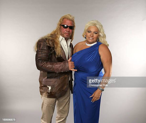 Personalities Duane Dog Lee Chapman and Beth Chapman pose at the Wonderwall portrait studio during the 2013 CMT Music Awards at Bridgestone Arena on...