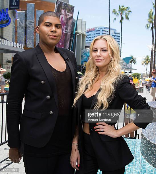 TV personalities EJ Johnson and Morgan Stewart attend 'Extra' at Universal Studios Hollywood on June 18 2015 in Universal City California