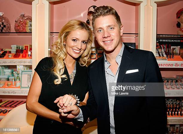 TV personalities Emily Maynard and Jef Holm attend Benefit Cosmetics Beauty Best Or Bust Party hosted by Emily Maynard at Macy's Herald Square on...