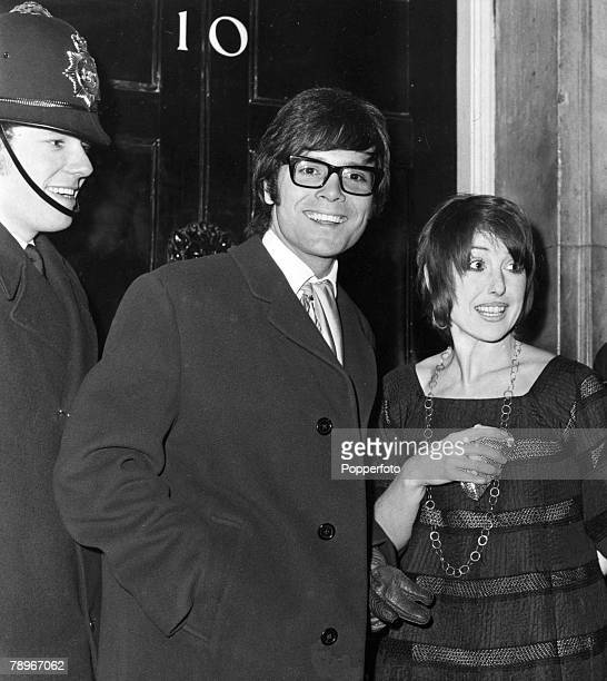 3rd March 1970 London British pop star Cliff Richard with actress Una Stubbs arriving at No 10 Downing Street for a reception