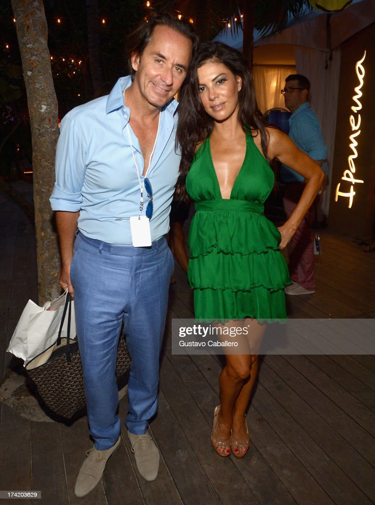 TV Personalities Frederic Marq and Adriana DeMoura pose with Ipanema at the L*SPACE By Monica Wise show during Mercedes-Benz Fashion Week Swim 2014 at Cabana Grande at the Raleigh on July 21, 2013 in Miami, Florida.