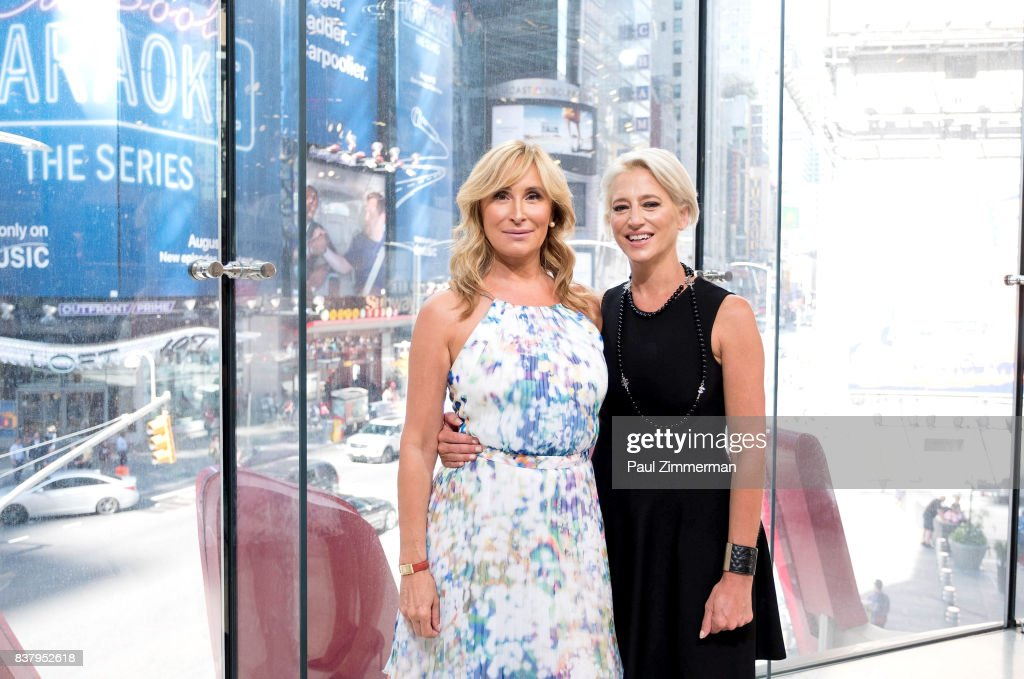 TV personalities from 'Real Housewives of New York' Sonja Morgan (L) and Dorinda Medley visit 'Extra' at their New York studios at H&M in Times Square on August 23, 2017 in New York City.