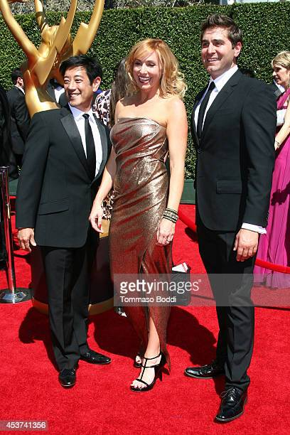 TV personalities Grant Imahara Kari Byron and Tory Belleci attend the 2014 Creative Arts Emmy Awards held at the Nokia Theatre LA Live on August 16...
