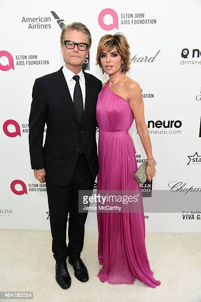 TV personalities Harry Hamlin and Lisa Rinna attend the 23rd Annual Elton John AIDS Foundation Academy Awards Viewing Party on February 22 2015 in...