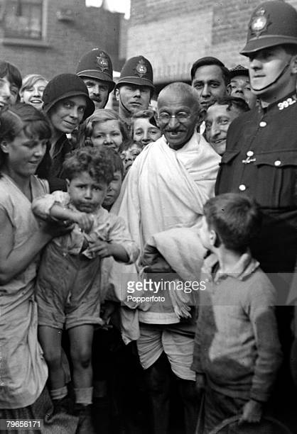 1931 Indian spiritual and political leader Mahatma Gandhi centre pictured in Bow London surrounded by an enthusiastic crowd before he was to attend a...
