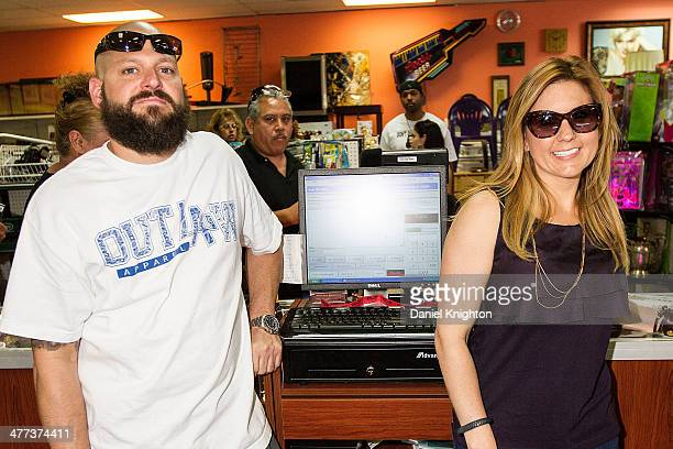 TV personalities Jarrod Schulz and Brandi Passante appear at the Storage Wars Season 4 Premiere Party at Now Then on March 8 2014 in Orange California