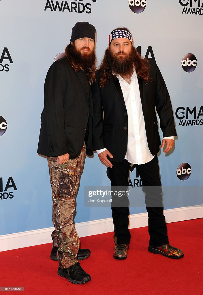 TV Personalities Jase Robertson and Willie Robertson of the hit show 'Duck Dynasty' attend the 47th annual CMA Awards at the Bridgestone Arena on November 6, 2013 in Nashville, Tennessee.