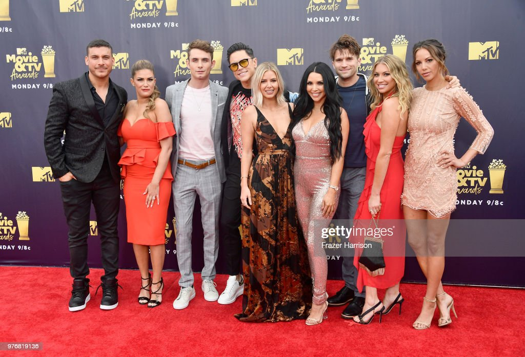 TV personalities Jax Taylor, Brittany Cartwright, James Kennedy, Ariana Madix, Tom Sandoval, Scheana Shay, Stassi Schroeder, Kristen Doute, and Tom Schwartz attend the 2018 MTV Movie And TV Awards at Barker Hangar on June 16, 2018 in Santa Monica, California.