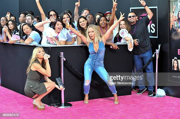 TV personalities Jessica Hall and Kendra Wilkinson pose for pictures with fans during the Premiere ff STX Entertainment's Bad Moms at Mann Village...
