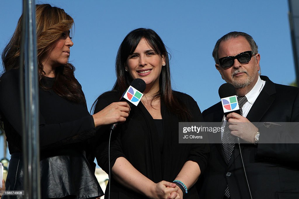 TV Personalities Jessica Maldonado (L) and Raul De Molina (R) interview actress Angelica Vale (C) during a special broadcast of their tv show 'El Gordo y la Flaca' outside the Gibson Amphitheater during Jenni Rivera Celestial Graduation at Universal City Walk on December 19, 2012 in Universal City, California.