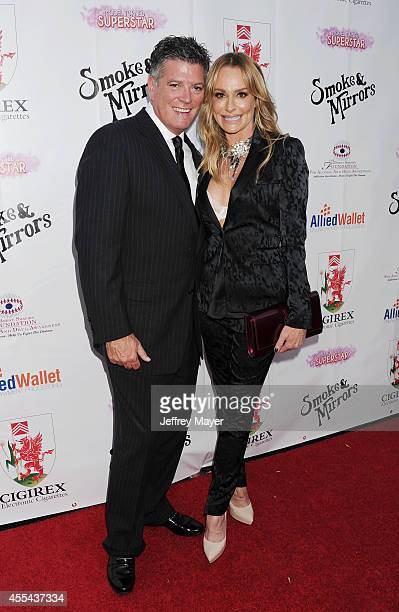TV personalities John Bluher and Taylor Armstrong attend the Brent Shapiro Foundation for Alcohol and Drug Awareness' annual 'Summer Spectacular...