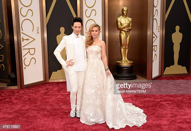 Personalities Johnny Weir and Tara Lipinski attend the Oscars held at Hollywood Highland Center on March 2 2014 in Hollywood California