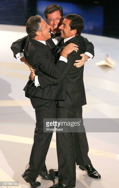 TV personalities Jon Stewart Steve Carell and Stephen Colbert celebrate onstage during the 59th Annual Primetime Emmy Awards at the Shrine Auditorium...
