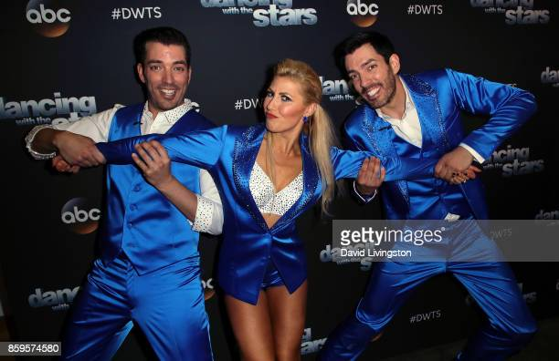 TV personalities Jonathan Scott and Drew Scott pose with dancer Emma Slater at 'Dancing with the Stars' season 25 at CBS Televison City on October 9...