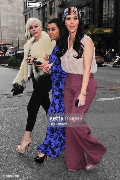 TV personalities Joyce Bonelli Kourtney Kardashian and Kim Kardashian walk in Midtown Manhattan on October 20 2011 in New York City
