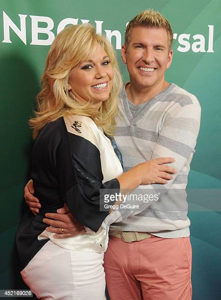 TV personalities Julie Chrisley and Todd Chrisley arrive at the 2014 Television Critics Association Summer Press Tour NBCUniversal Day 2 at The...