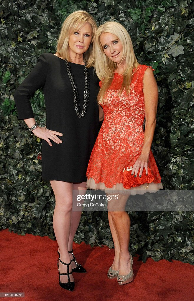 TV personalities Kathy Hilton and sister/actress Kim Richards arrive at the QVC 'Red Carpet Style' party at Four Seasons Hotel Los Angeles at Beverly Hills on February 22, 2013 in Beverly Hills, California.