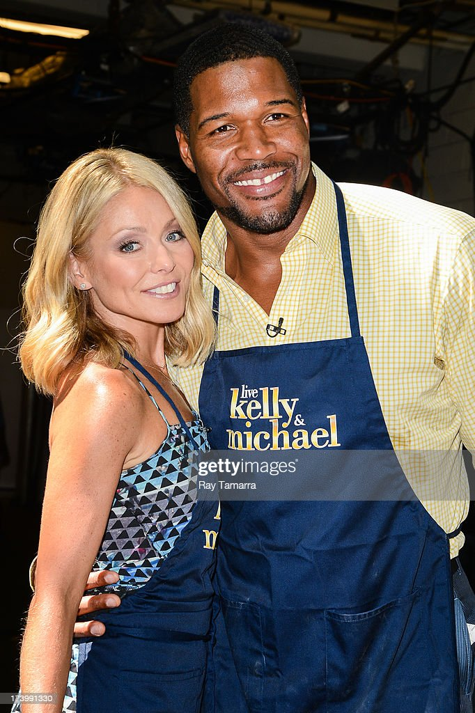 TV personalities Kelly Ripa (L) and Michael Strahan host the 'Live Wtih Kelly And Michael' taping at the ABC Lincoln Center Studios on July 18, 2013 in New York City.