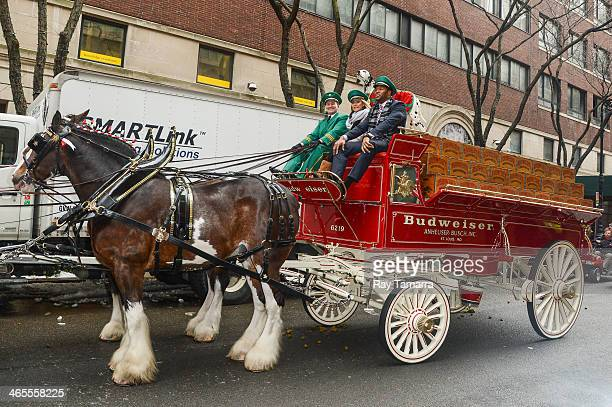 TV personalities Kelly Ripa and Michael Strahan ride the Budweiser Clydesdales wagon at the Live With Kelly And Michael taping at the ABC Lincoln...