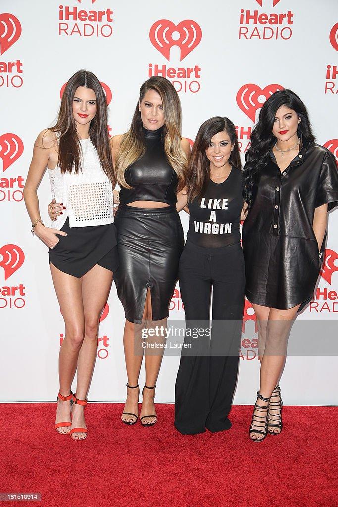 TV personalities Kendall Jenner, Khloe Kardashian, Kourtney Kardashian and Kylie Jenner pose in the iHeartRadio music festival photo room on September 21, 2013 in Las Vegas, Nevada.