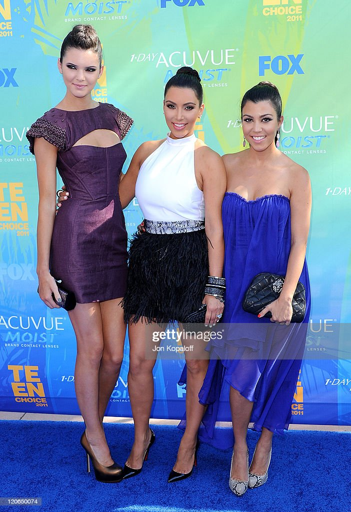 TV personalities Kendall Jenner, Kim Kardashian and Kourtney Kardashian arrive at the 2011 Teen Choice Awards held at Gibson Amphitheatre on August 7, 2011 in Universal City, California.