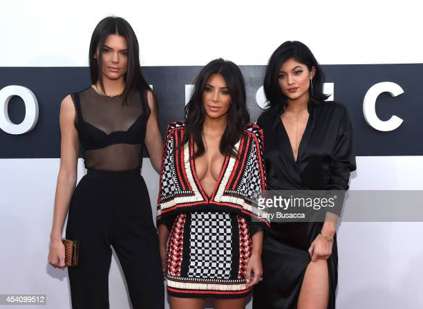 TV personalities Kendall Jenner Kim Kardashian and Kylie Jenner attend the 2014 MTV Video Music Awards at The Forum on August 24 2014 in Inglewood...