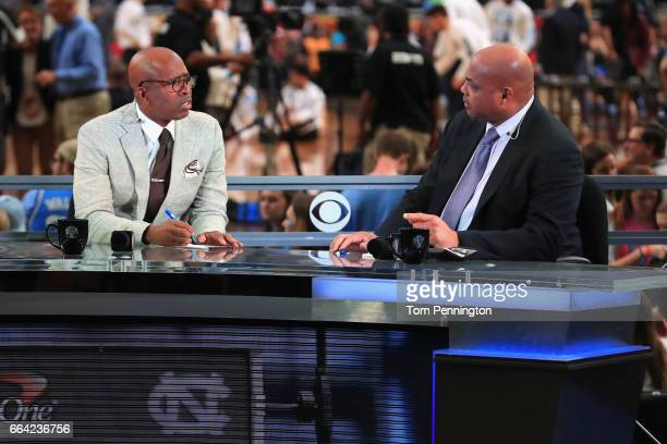 TV personalities Kenny Smith and Charles Barkley look on before the game between the Gonzaga Bulldogs and the North Carolina Tar Heels during the...