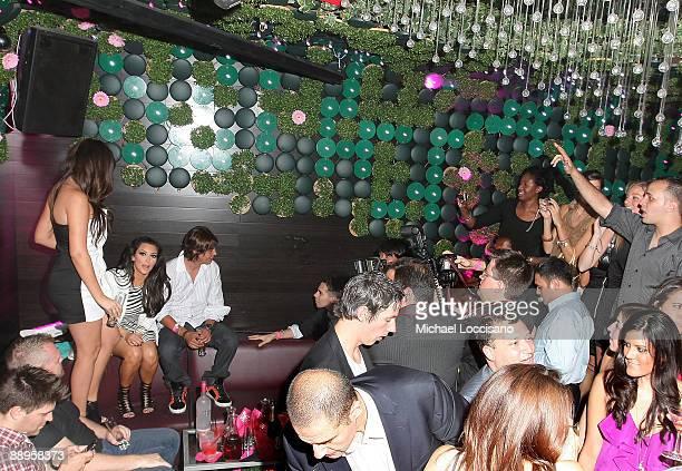 TV personalities Khloe Kardashian and Kim Kardashian and publicist Jonathan Cheban attend the ThreeO Vodka Bubble launch at Greenhouse on July 9 2009...