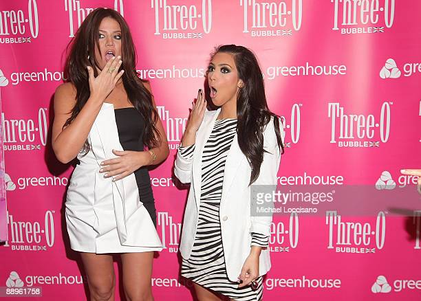 TV personalities Khloe Kardashian and Kim Kardashian attend the ThreeO Vodka Bubble launch at Greenhouse on July 9 2009 in New York City